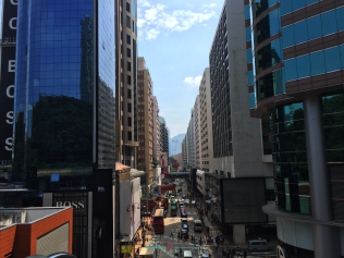 Among with a great road , is also the view in the background is the Hong Kong Culture Center one of many iconic Hong Kong theater buildings