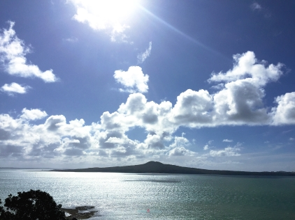 Rangitoto Island with the teal mussel textured water ripples of Hauraki Gulf...