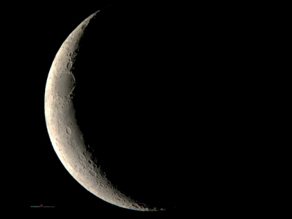 The crescent moon Luna as she is earth shadowed showing her fresh cratered features..