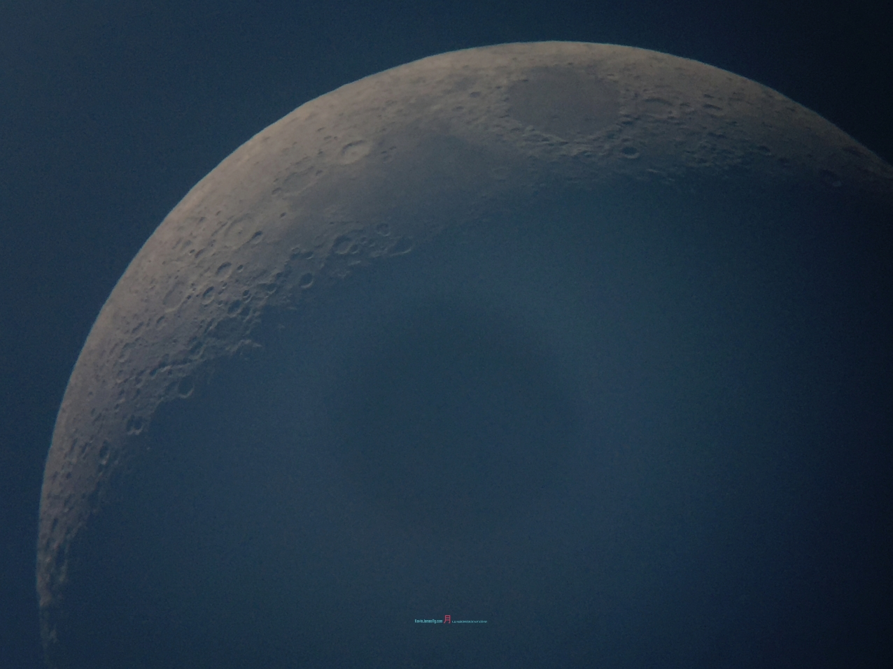 the sunset crescent moon - looking at circumference shows it not round but with cratered mountains ..