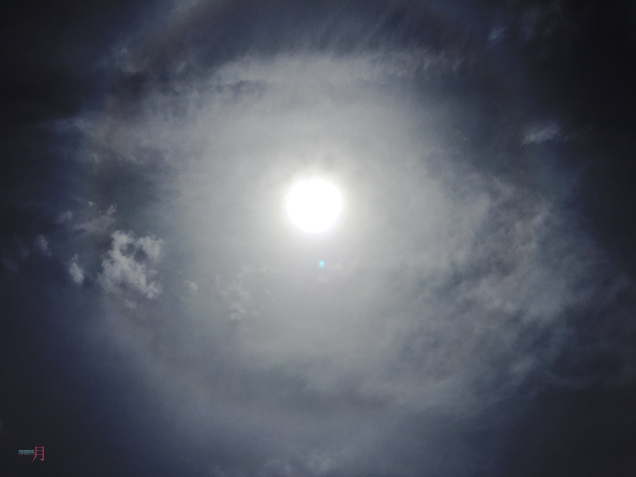 Ghostly halos of the sun with rainbow rings..