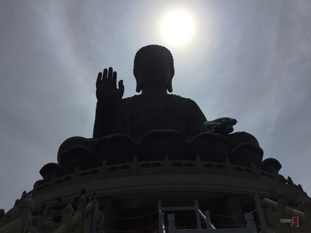 over at Ngong Ping 360, Lantau Island Hong Kong... a solar rainbowic halo over hangs in the background creating a brilliant Chinese like painting that can be found in illustrations and temples..