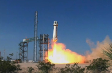 Mission nine launching from a very clear dry day is the the Blue Origin New Shepard for crew flight certification..